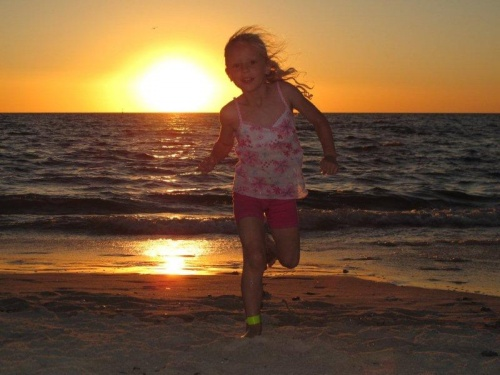 Amaya running on the beach